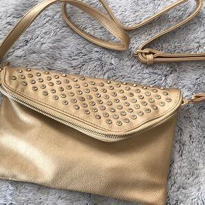 Charming Charlie gold crossbody purse